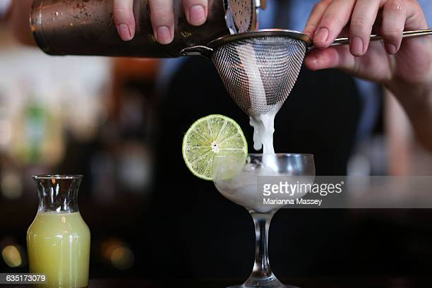 bartender pouring a cocktail - mixing stock pictures, royalty-free photos & images