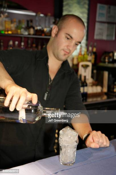 A bartender pouring a drink at The Wave Hotel