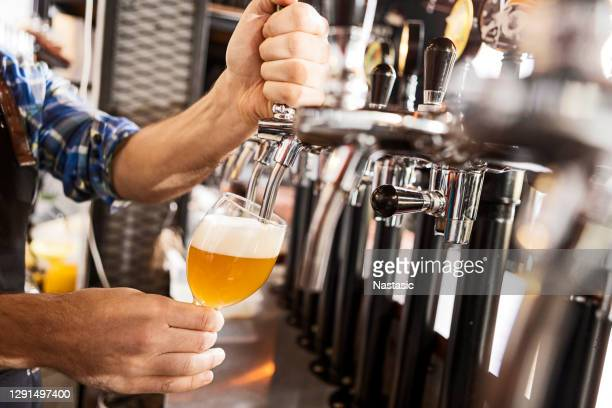 bartender pouring beer - pump dress shoe stock pictures, royalty-free photos & images