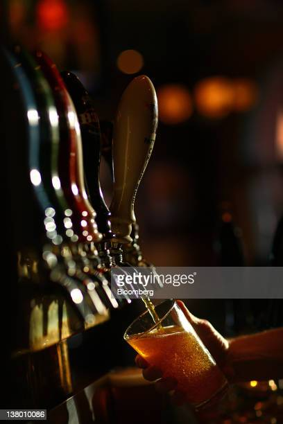 A bartender pours a beer for a customer at the Wynkoop Brewing Co in Denver Colorado US on Thursday Jan 26 2012 The Wynkoop Brewing Co was founded in...