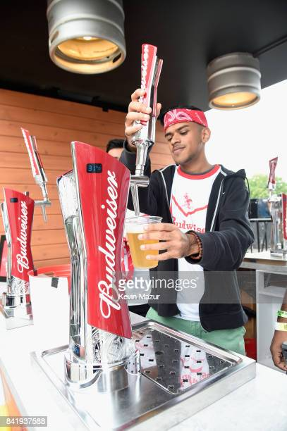 A bartender pours a beer from a tap in the Bud Block area during the 2017 Budweiser Made in America festival Day 1 at Benjamin Franklin Parkway on...