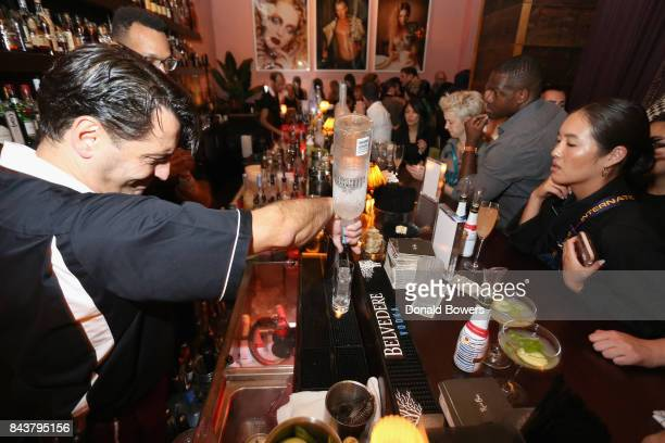 A bartender pours a drink at the launch of Mission Magazine with Belvedere Vodka at Rose Bar at Gramercy Park Hotel on September 6 2017 in New York...