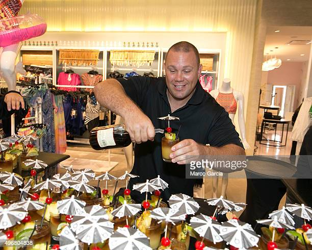 A bartender pours a Hawaiian mai tai drink at the gala celebration for the opening of the new Bloomingdale's store at the Ala Mona Center on November...