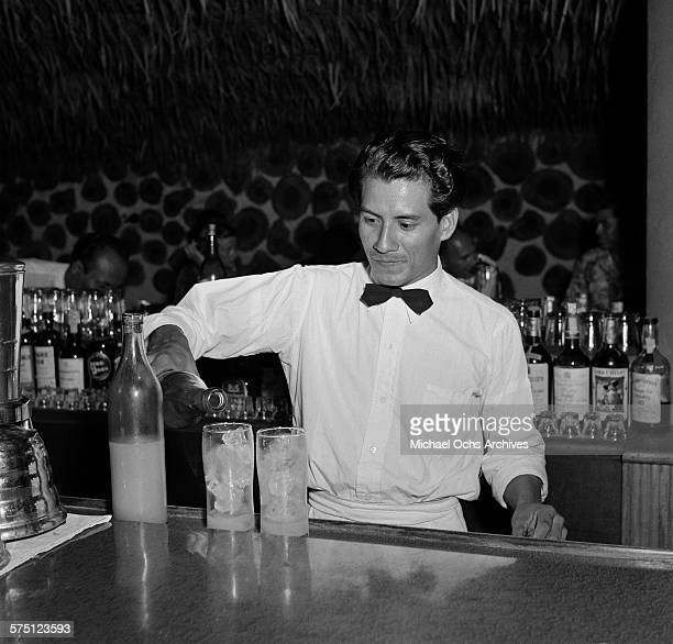 A bartender pours drinks in downtown Mexico City Mexico