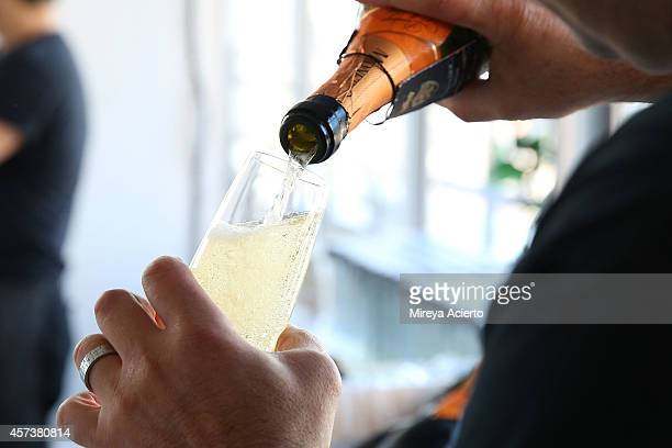 A bartender pours Mionetto Prosecco at Founder's Welcome Breakfast during Food Network New York City Wine Food Festival Presented By FOOD WINE at...