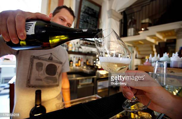 A bartender pours Prosecco wine into a glass for an Italian oenologist to test for authenticity at a restaurant in Treviso Italy on Tuesday Sept 3...