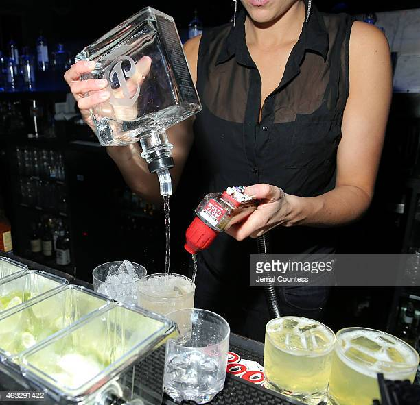 A bartender prepares a cocktail made with DeLeon Tequila at the VFILES MADE FASHION After Party during MercedesBenz Fashion Week Fall 2015 at Space...