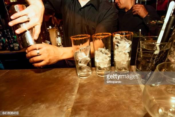 Bartender prepares some drinks