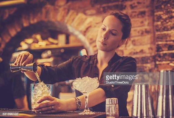 bartender preparing a cocktails
