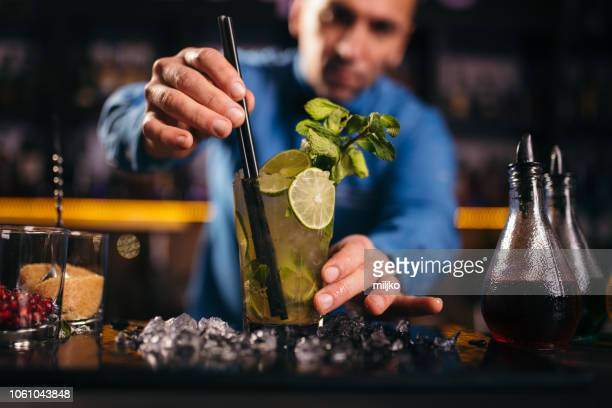 bartender preparing cocktail in nightclub - mojito stock photos and pictures