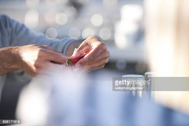 Bartender preparing fruit garnish