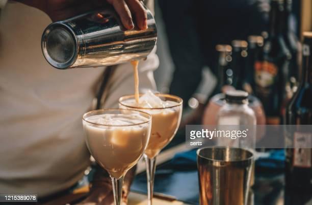 bartender preparing  irish cream liqueur cocktail with shaker - irish culture stock pictures, royalty-free photos & images