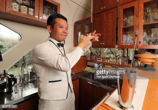 A bartender serves a cocktail at the lounge of the JR East's 'Train Suite ShikiShima' during the press preview on April 26 2017 in Tokyo Japan The...