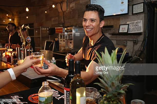 A bartender serves a guest at The 7th Annual Saveur Summer Cookout at Boat Basin Cafe on June 21 2016 in New York City