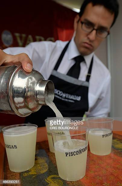 A bartender serves a Pisco Sour at a stand in a street festival in Lima on February 1 during celebrations for the national Day of Pisco Sour an...