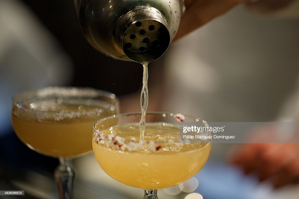 A bartender serves cocktails during the Mix&Shake congress at 'El Matadero' on April 9, 2014 in Madrid, Spain. Mix&Shake is a conference for professionals of the cocktail bartending industry.