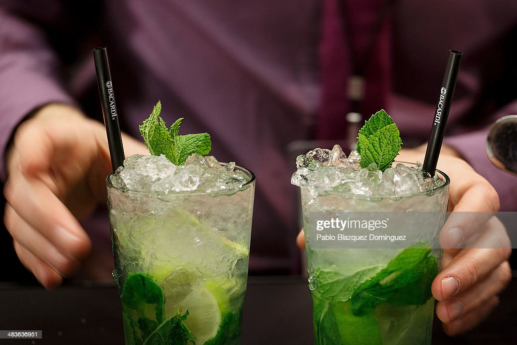 A bartender serves two Mojito cocktails during the Mix&Shake congress at 'El Matadero' on April 9, 2014 in Madrid, Spain. Mix&Shake is a conference for professionals of the cocktail bartending industry.