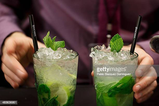 A bartender serves two Mojito cocktails during the MixShake congress at 'El Matadero' on April 9 2014 in Madrid Spain MixShake is a conference for...