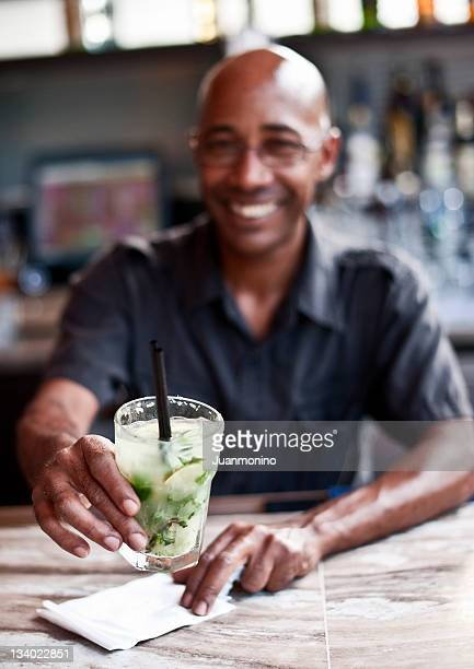 bartender serving a mojito cocktail - creole ethnicity stock pictures, royalty-free photos & images