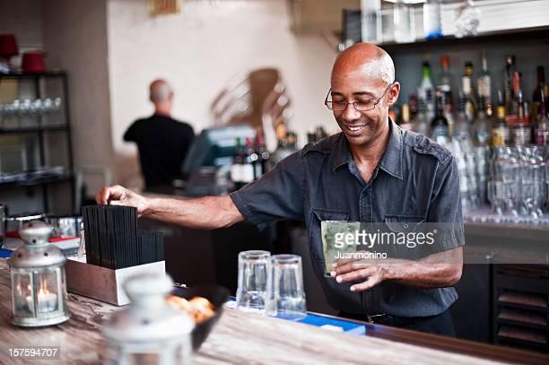 Bartender serving a mojito