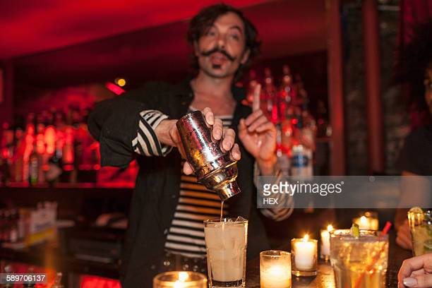 bartender serving drinks at a nightclub - candle light stock pictures, royalty-free photos & images