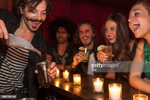 Bartender serving drinks at a nightclub