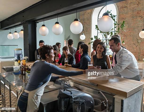 Bartender serving drinks at the bar