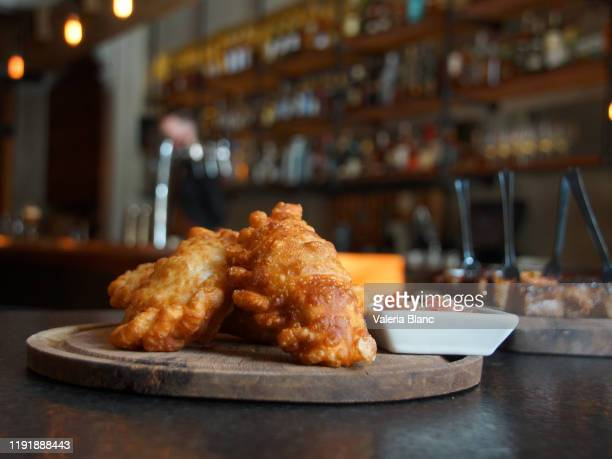 bartender serving food - empanada stock pictures, royalty-free photos & images