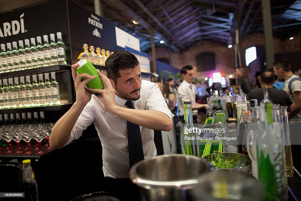 A bartender shakes a Cranberry Caipirinha cocktail during the Mix&Shake congress at 'El Matadero' on April 9, 2014 in Madrid, Spain. Mix&Shake is a conference for professionals of the cocktail bartending industry.