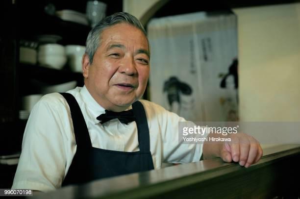 bartender smiling at bar counter
