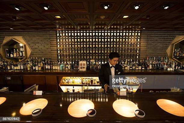 A bartender stands behind the bar at the Old Imperial Bar at the Imperial Hotel in Tokyo Japan on Friday Aug 19 2016 Tokyo's Imperial Hotel the...