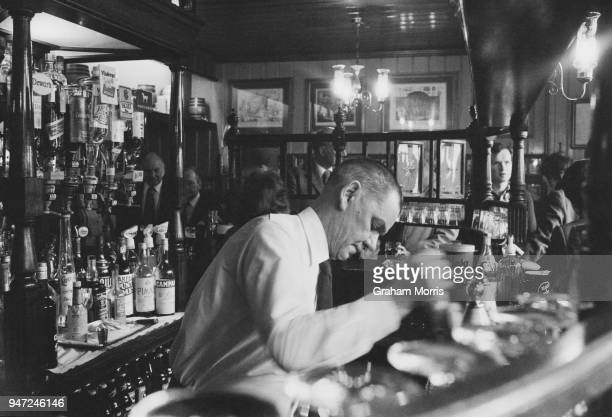 A bartender taps a a pint of beer at a Young's pub The Lamb in Bloomsbury London UK 16th May 1977