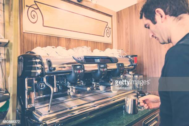 Bartender using espresso machine