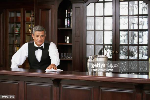 Bartender wiping counter