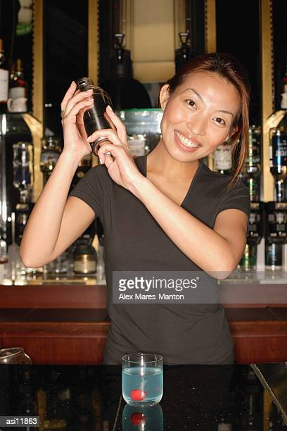 Bartender with cocktail mixer