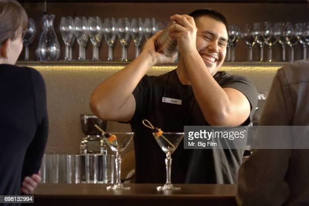 Bartender with Cocktail Shaker in Motion