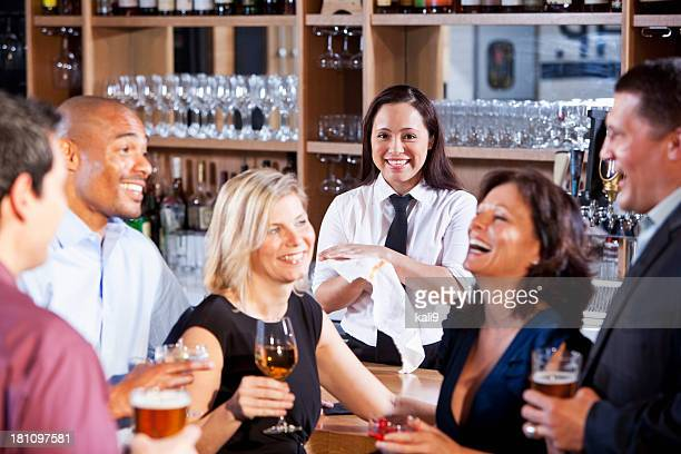 Bartender with group at bar