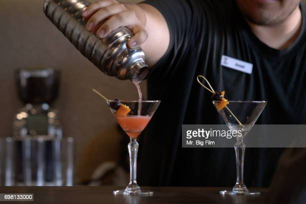 Bartender with Pouring a Drink into a Martini Glass