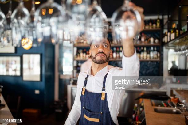 bartender working at the cafe - bartender stock pictures, royalty-free photos & images