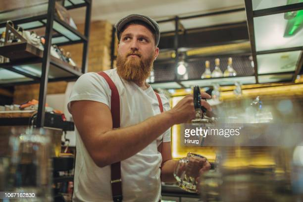 bartender working in pub - artisan stock photos and pictures