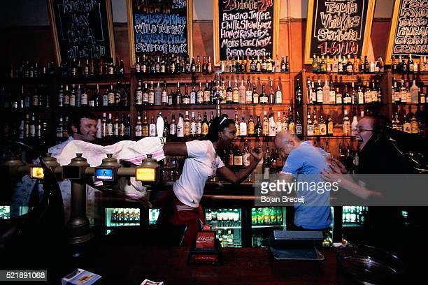 bartenders playing around - brixton stock pictures, royalty-free photos & images