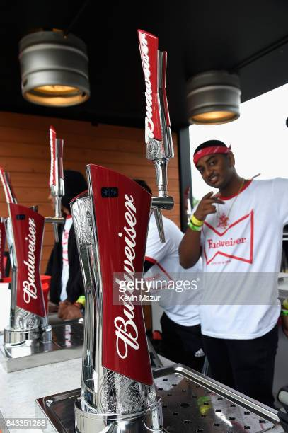 Bartenders pose in the Bud Block during 2017 Budweiser Made in America Day 1 at Benjamin Franklin Parkway on September 2 2017 in Philadelphia...