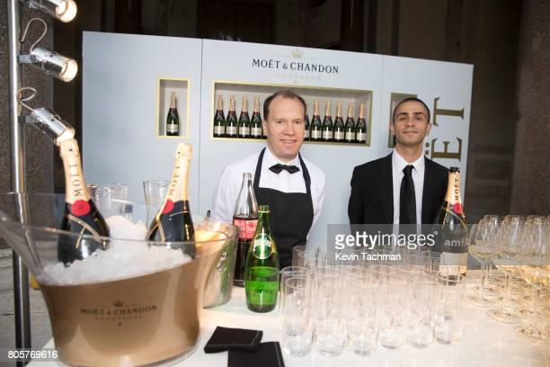 Bartenders prepare glasses of Moet Chandon inside the amfAR Paris Dinner at Le Petit Palais on July 2 2017 in Paris France