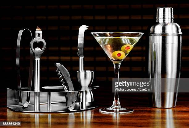 Bartending Tools And Martini Glass On Wooden Table At Bar