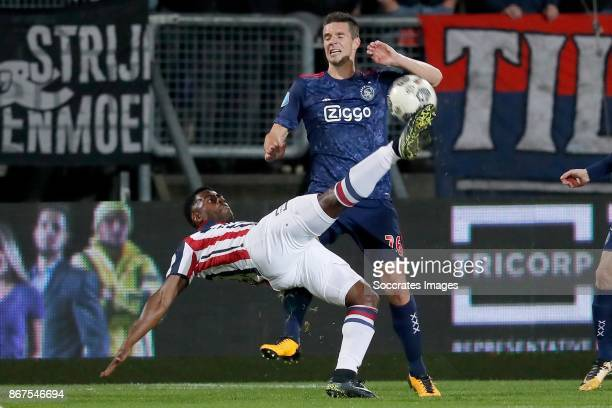 Bartholomew Ogbeche of Willem II Nick Viergever of Ajax during the Dutch Eredivisie match between Willem II v Ajax at the Koning Willem II Stadium on...