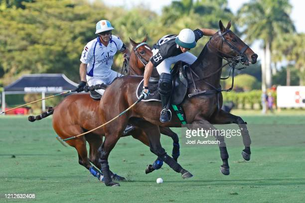 Barto Castagnola of Richard Mille plays the ball in front of Adolfo Cambiaso of Valiente during The Palm Beach Open on March 15 2020 at the Grand...