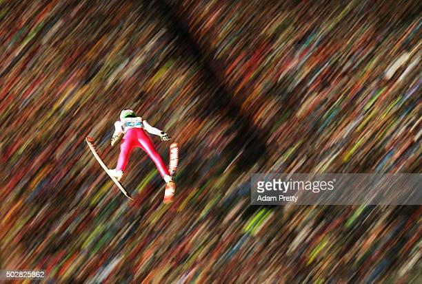 Bartol Tilen of Slovenia soars through the air during his 1st round jump on Day 2 of the 64th Four Hills Tournament on December 29 2015 in Oberstdorf...
