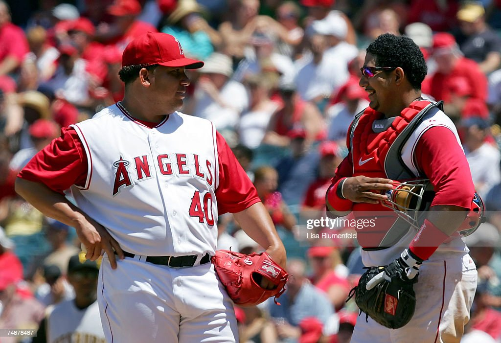 Bartolo Colon #40 and Jose Molina #28 of the Los Angeles Angels of Anaheim meet on the mound during the game against the Pittsburgh Pirates at Angels Stadium on June 24, 2007 in Anaheim, California.