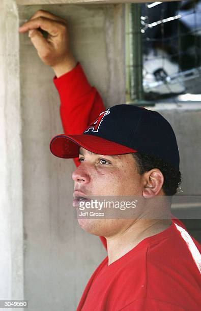Bartolo Colon of the Anaheim Angels looks on from the dugout after being pulled in the first inning during a spring training game against the Oakland...
