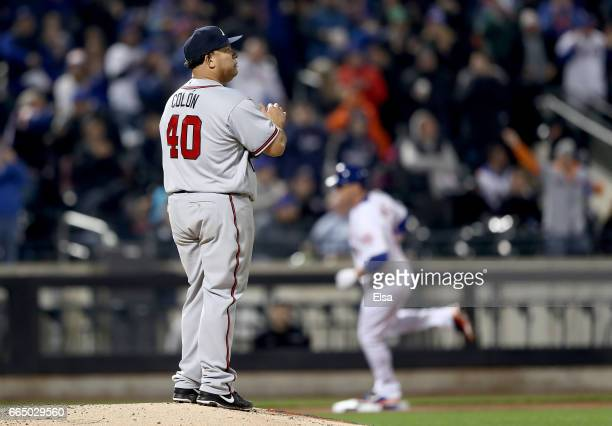 Bartolo Colon of the Atlanta Braves reacts as Jay Bruce of the New York Mets rounds the bases after a solo home run in the fifth inning on April 5...
